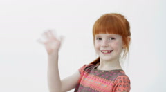 Little ginger girl  turning, waving hand and smiling, hello (bye) gesture, wh Stock Footage