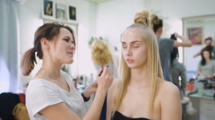Transformation. In the trendy beauty salon, a professional makeup artist - stock footage