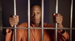 African American Man Behind Bars - Racism in the prison system - stock footage