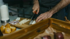 Restaurant Chef preparing ingredients for a salad Stock Footage