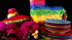 Cinco de Mayo Party table with donkey and sombrero hat pinatas, panning close Stock Footage