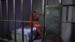 Prison cell door opens to release caucasian inmate Stock Footage