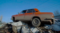 Old Rusty Car in Junkyard Awaits For Recycling - stock footage
