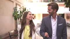 Happy young couple walking through old town Stock Footage