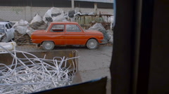 Old Car in Junkyard Awaits For Recycling Metal - stock footage