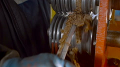 Worker Cleaning Metal Wire from Waste Stock Footage