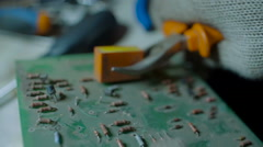 Demounting the Electronic Circuit Board Apart with Pliers Stock Footage