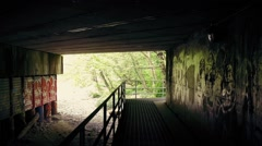 Moving Under Bridge With Graffiti On Walls - stock footage