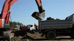 An excavator and truck are loading soil. Stock Footage