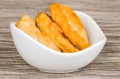 Closeup delicious empanadas lying in a small white bowl Stock Photos