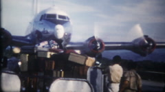 3245 propeller driven passenger airplane rolls to gate - vintage film home movie Stock Footage