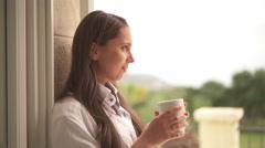 Young woman enjoying coffee Stock Footage