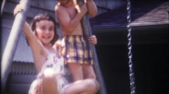 Acrobatic children on the swing set at home - 3244 vintage film home movie Stock Footage