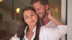 Happy young couple at home in the morning Stock Footage