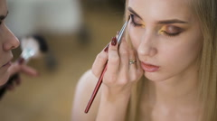 For sensual blonde in a beauty salon doing make-up. Emphasizes the eyes with Stock Footage