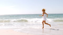 A woman is running and jumping Stock Footage