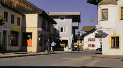 P1030506-2 unidentifiable men walk away quiet German village street Stock Footage