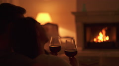 Couple drinking red wine at home Stock Footage