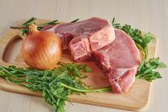 Cut pork and seasonings Stock Photos
