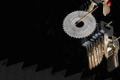 Blank car keys and milling cutter saw Stock Photos