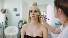 fashion stylist, creating an image for the top model. She was prepared for a - stock footage