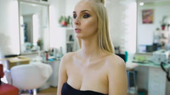 Fashion stylist, creating an image for the top model. She was prepared for a Stock Footage