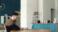 Handsome man working with laptop in cafe Stock Footage