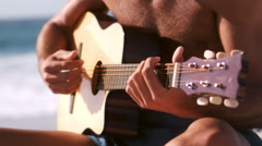 A man is playing with his guitar Stock Footage