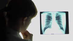 Pneumonia, therapist analyzing lungs x-ray image, making conclusions, healthcare Stock Footage