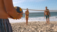 A group of friends is playing volleyball Stock Footage