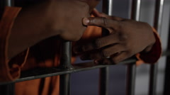 Remorseful prisoner in jail cell Stock Footage