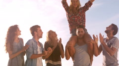 A group of friends are enjoying their holidays with balloons Stock Footage