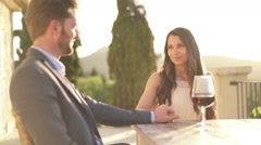 Beautiful couple in love with wine sitting outside Stock Footage