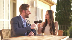 honeymoon couple cheering with wine on terrace - stock footage
