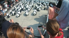 People take photos with papier-mache pandas - stock footage