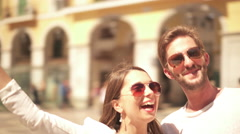 young couple making selfie with smartphone in old town - stock footage