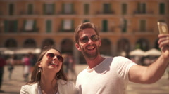 Hipster couple making selfie in historical center Stock Footage