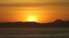 Lovely golden sunrise over the ocean in False Bay, South Africa Stock Footage