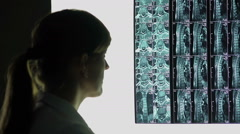 Rare case of spinal injury, doctor looking at patient's x-ray, making diagnosis Stock Footage