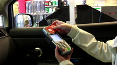 Close up woman tapping credit card at payment terminal at Canadian tire store Stock Footage