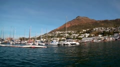 View of Simon's Town harbor from a boat in False Bay in South Africa  Stock Footage