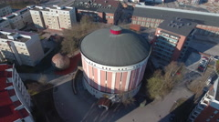 An old gas holder in an urban enviroment, 4K aerial footage - stock footage