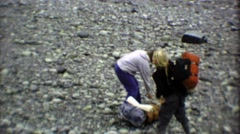 1974: Teenage backpack hikers camping in the wilderness bush. Stock Footage