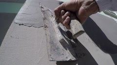 Close-up worker plastered wall with a trowel Stock Footage