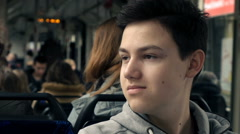 Young teenager sitting in tram, super slow motion 240fps Stock Footage