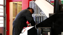 Car mechanic checking car oil level at Canadian tire store Stock Footage