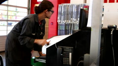 Car mechanic updating inforamtion for customer at Canadian tire store Stock Footage