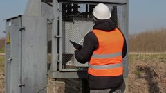 Electrician inspect the transformer technical condition Stock Footage