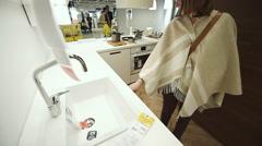 Woman choosing kitchen furniture Stock Footage