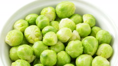 brussels sprouts in bowl tracking shot - stock footage